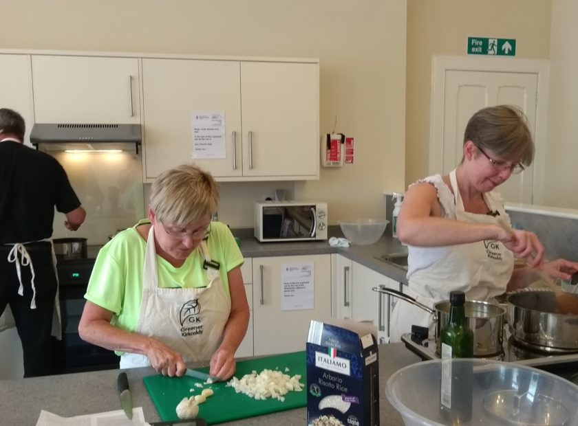 people cooking in community food hub