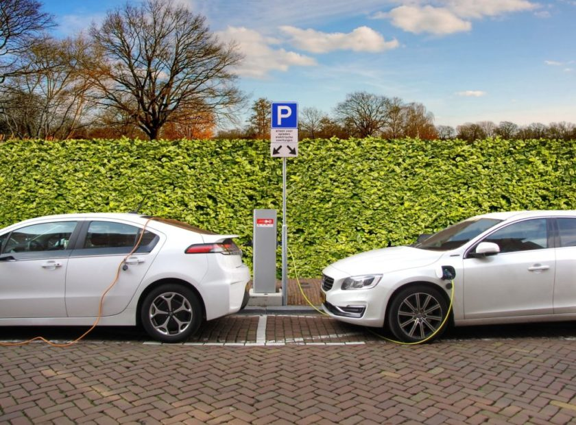 two electric cars at charging points