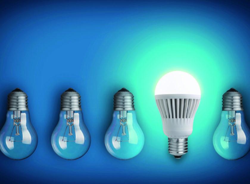 row of light bulbs and glowing LED bulb
