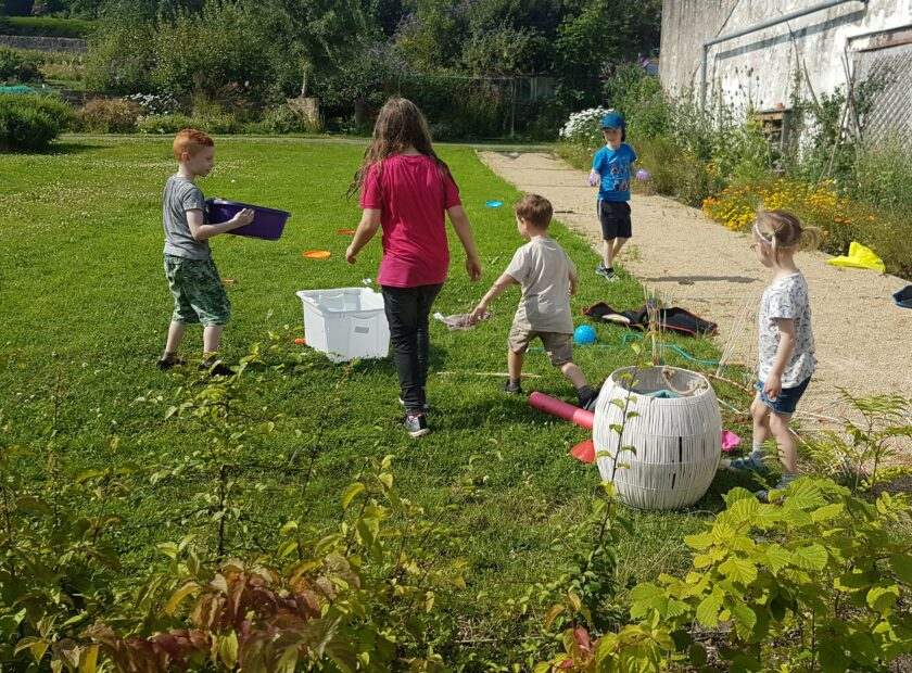 community climate action - kids playing on the grass